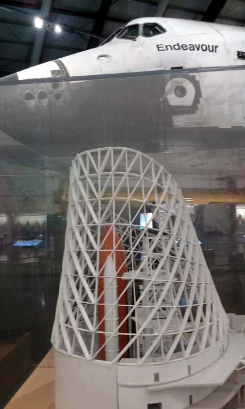The model of the Samuel Oschin Air and Space Center with Endeavour in the background, as of June 2016.