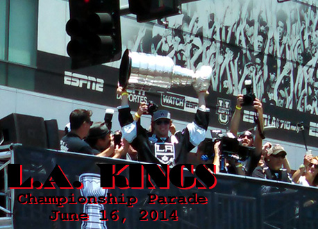 The Stanley Cup trophy is hoisted into the air by team center Anze Kopitar during the L.A. Kings' championship parade on June 16, 2014.