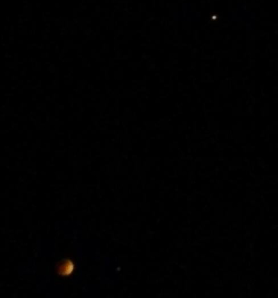 A smartphone photo that I took of the Blood Moon and Mars (upper right-hand corner) during the total lunar eclipse on April 15, 2014.
