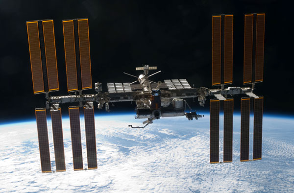 The International Space Station, as seen from space shuttle Discovery after she undocked from the orbital outpost on March 7, 2011